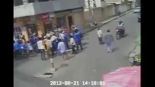 a thief getting caught up and beat up by a bunch of people