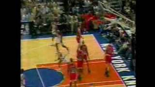 John Starks' amazing acrobatic move to the basket.
