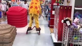 Geoffrey The Giraffe Riding A Scooter