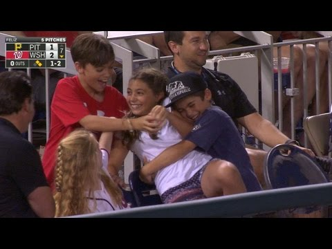 Young fans hug girl who gets a foul ball