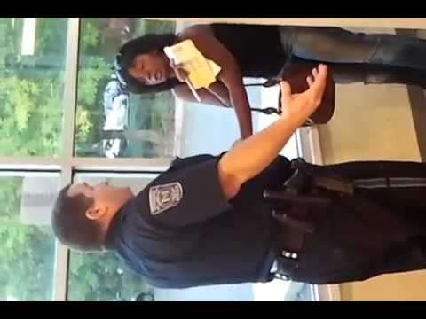 Racist cop harrasing mother in front of kids - PoliceBrutality.us