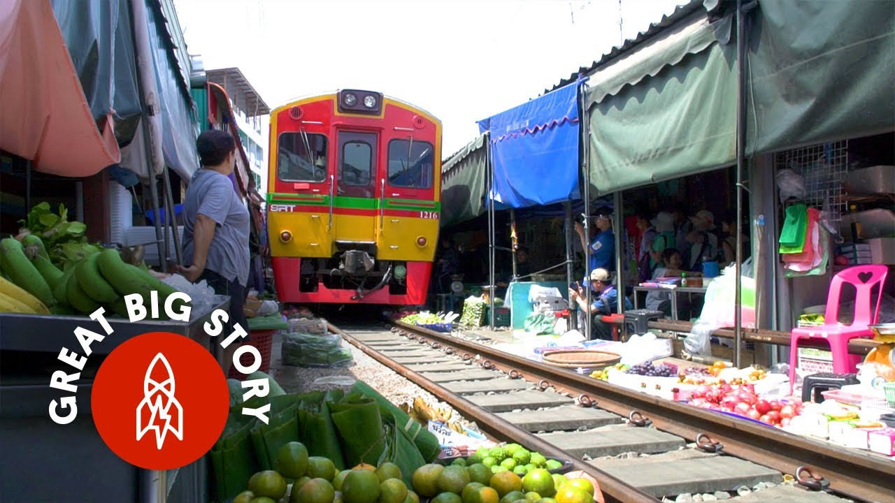 A Train Runs Through It Thailand s Most Dangerous Market