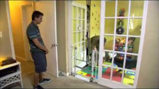 Toby Grimes trains his dog to fetch a diaper