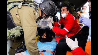 Israeli Soldiers Pull An Injured Palestinian Out Of An Ambulance