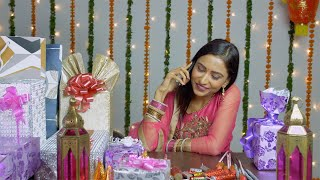 Beautiful young woman busy greeting her friends over a call on the occasion of Diwali