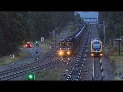 Long coal train in NSW (Australia) overtaken by a Cityrail passenger railcar