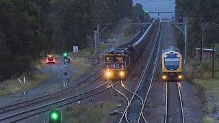 Long coal train in NSW (Australia) overtaken by a Cityrail passenger railcar