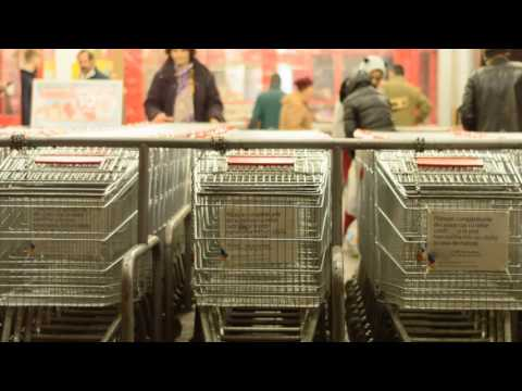 Free footage. Shopping cart and people in supermarket Timelapse