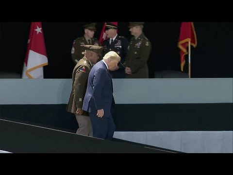 Trump appears to steady himself walking down West Point ramp