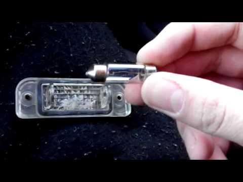 как поменять лампочку освещения номера на киа сид