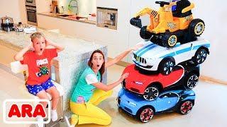 ركوب نيكيتا الصغير على السيارات والسيارات السحرية الملونة