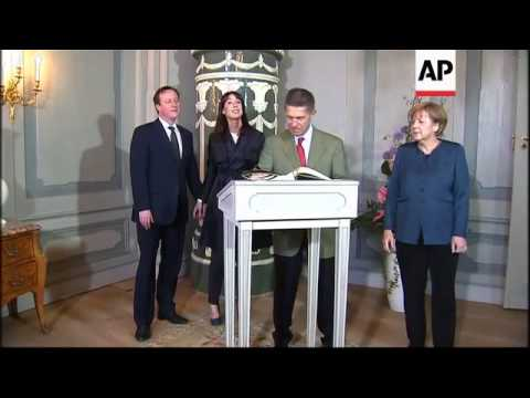 Cameron and his wife welcomed by Merkel and her husband