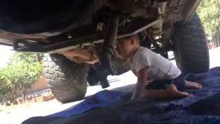 3 year old working on a JEEP CHEROKEE