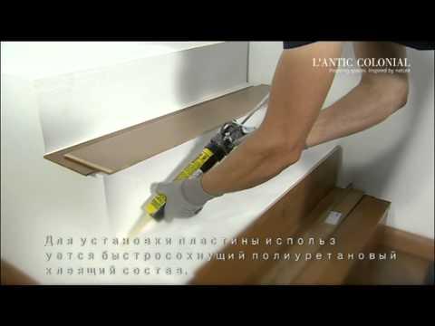 Укладка деревяных угловых элементов на лестнице