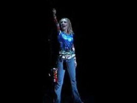 Courtney Corey as Maureen in Rent