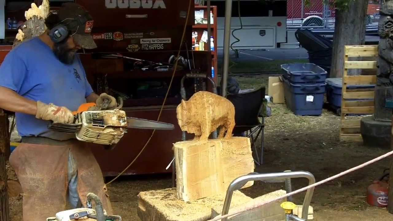 In action chainsaw wood carving artist evergreen state