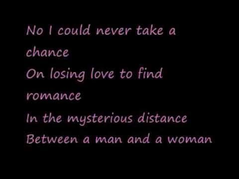 U2-A Man and a Woman (Lyrics)