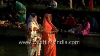 Women offer prayers to Sun God during Chhath Puja in India