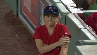 Ballgirl makes stop on a ball in play