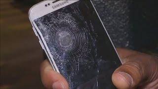 Paris attacks: Mobile phone saves man