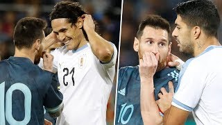 Lionel Messi in bust up with Edinson Cavani during match Argentina - Uruguay