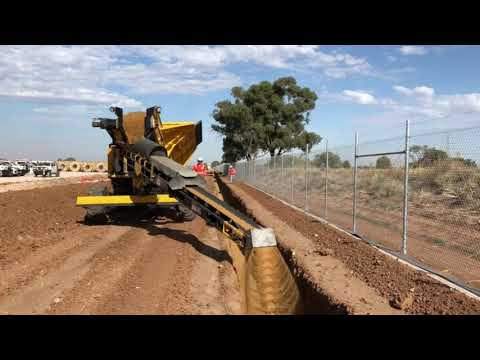 Stone slinger back-fills Solar Farm cable trench by Metropolis Services Australia