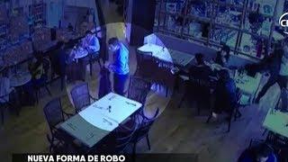 Dos sujetos elegantemente vestidos realizaron robo en restaurante - CHV NOTICIAS