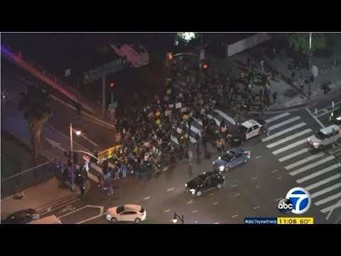 ICE Protesters Block 101 Freeway On-ramp In Downtown LA