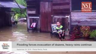 Flooding forces evacuation of dozens, heavy rains continue