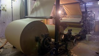 Slow motion shot of a corrugation machine at work in an industrial area