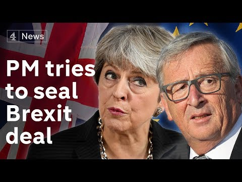 May tries to seal Brexit deal in Brussels