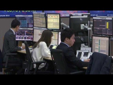 Asian stocks slide as global markets fear interest rate rise