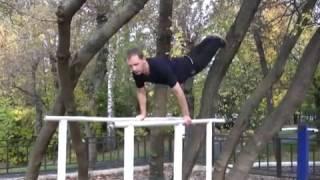 Соскок с гимнастических брусьев на махе вперед