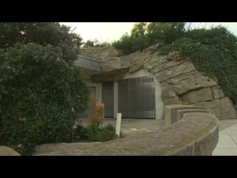 15 million beach house built into a rock youtube for Cost to build a house in little rock