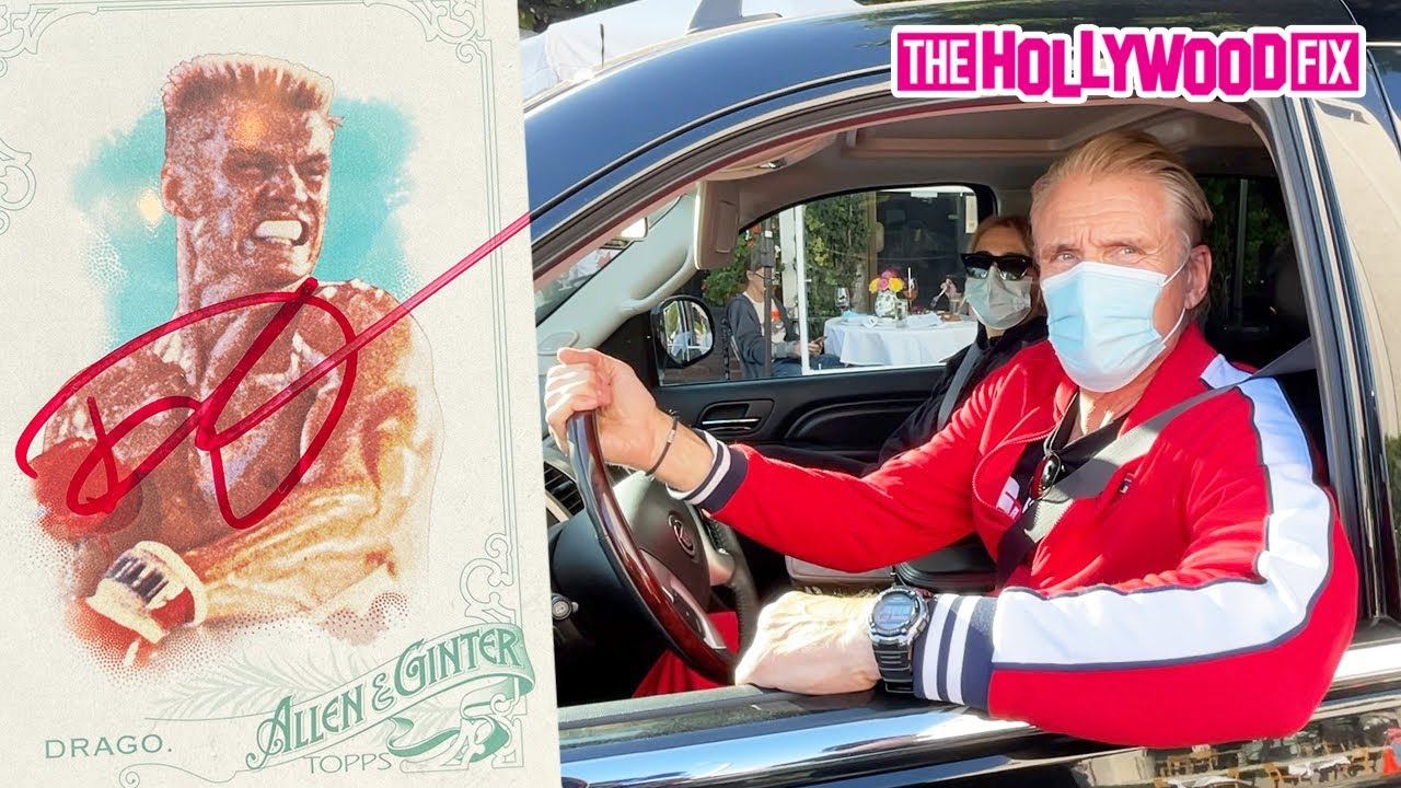 Dolph Lundgren Signs A 2015 Allen & Ginter 'Ivan Drago' Card While Leaving The Ivy With Emma Krokdal