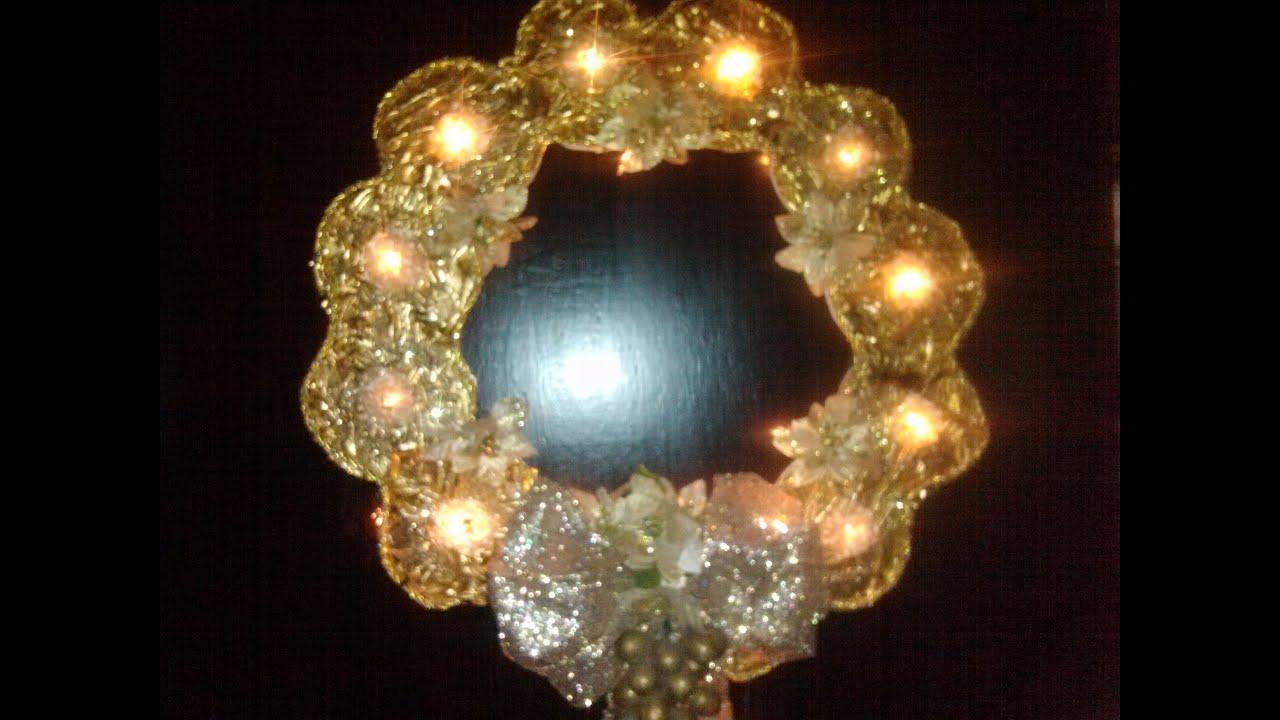 Corona de navidad iluminada hecha con cds how to make a for Coronas de navidad