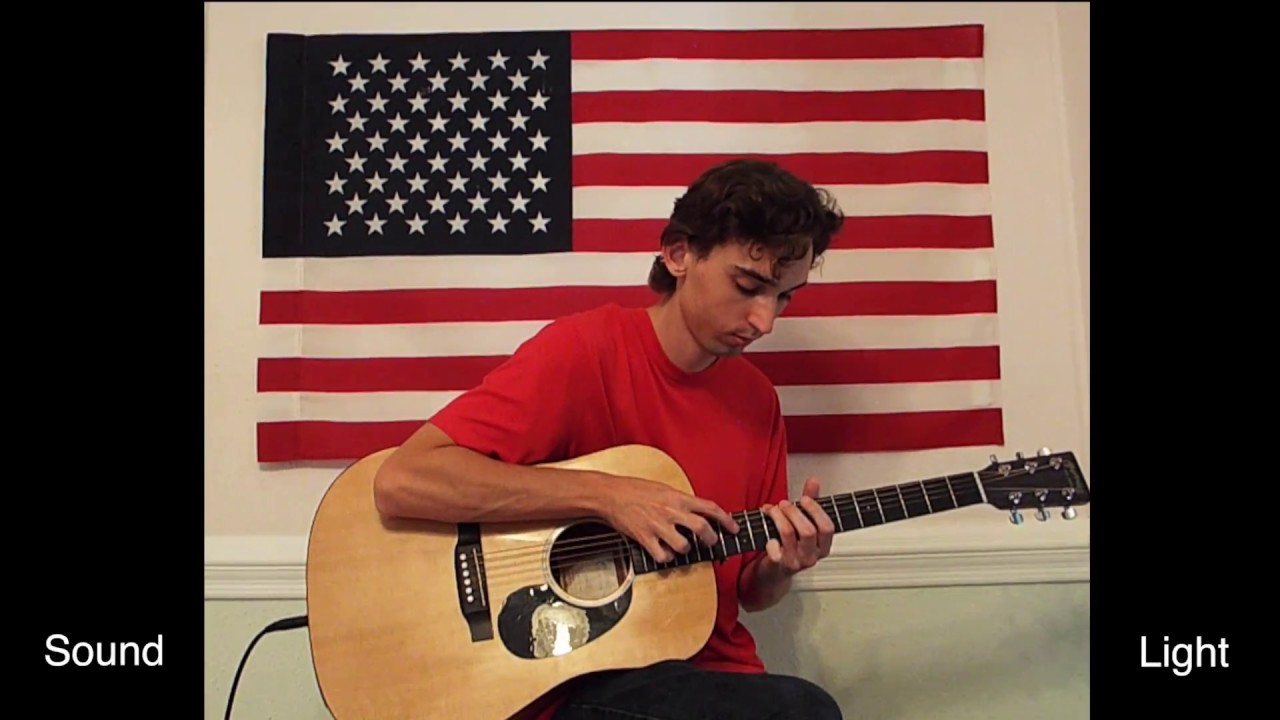 Musician Simultaneously Performs Amazing Grace And The Star Spangled Banner On One Acoustic Guitar