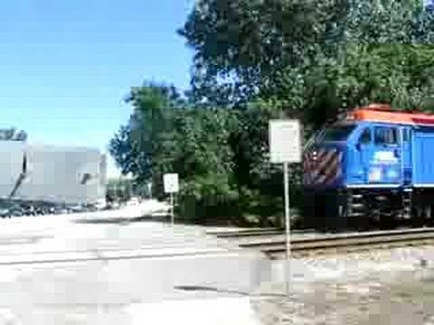 Metra passes through dundee road crossing in wheeling IL