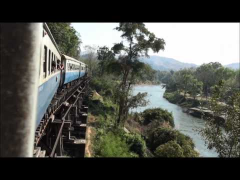 A train crosses the Wampo Viaduct along the River Kwai