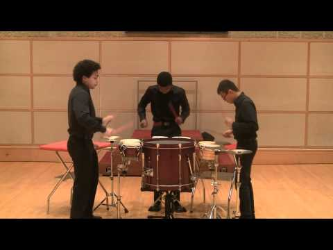 Three former students performing Trio Per Uno.