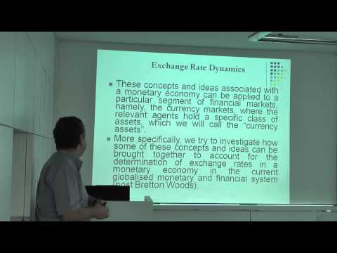 Exchange Rate Dynamics in a Peripheral Monetary Economy