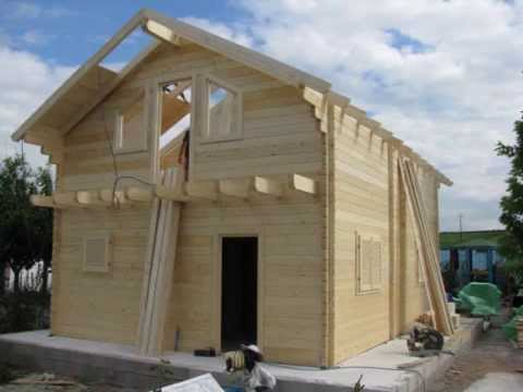 Construction chalet bois en kit de 96 m paisseur 80 mm for Fabricant garage bois en kit