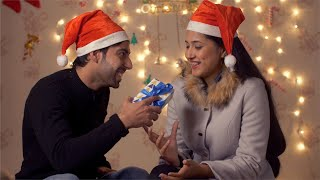 Christmas Eve - Young Indian woman hugs her husband when she receives surprise gift