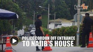 Police cordon off entrance to Najib's house