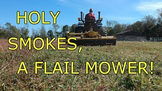 Trying out the Alamo SHD74 flail mower on the New Holland TC33D.