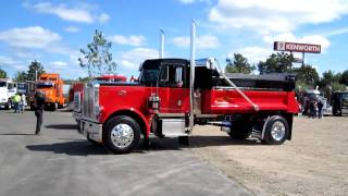 Western Star and Peterbilt 359 dump trucks pull into the show and park