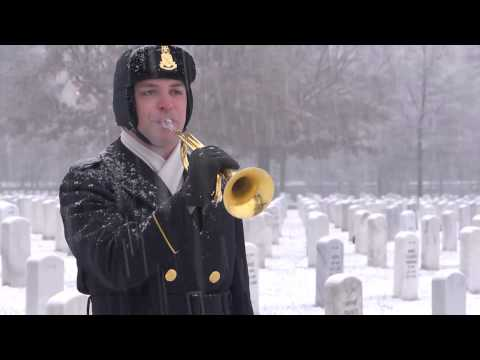 """""""Taps"""" performed by United States Army Band Bugler in Arlington National Cemetery in snow."""