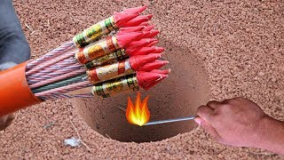 ONE HOLE AND LOTS OF DIWALI FIRECRACKERS ROCKET thumbnail