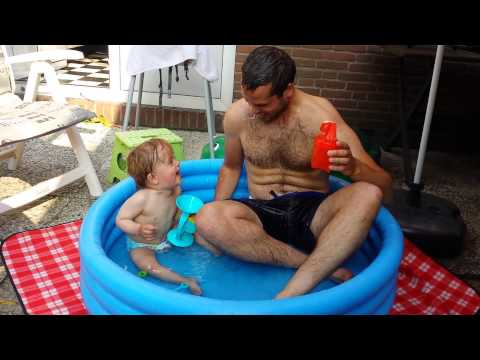 Baby fun funny laughing with dad daddy in mini pool hilarious