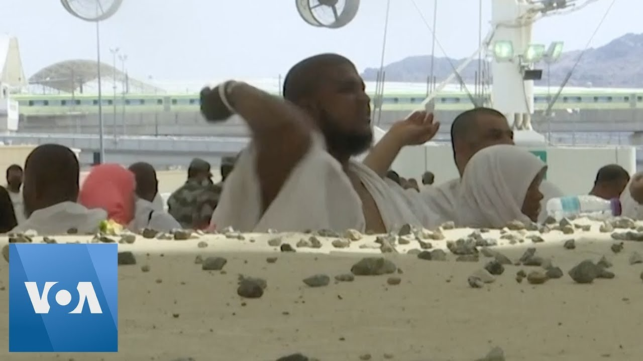 Download Hajj Pilgrims Participate in 'Stoning of Devil' Tradition in Saudi Arabia